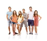 Group of happy students. Group of happy young teenager students standing, isolated on white background. Best friends Royalty Free Stock Photo