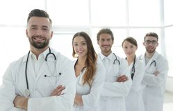 Group of happy successful doctors standing in a row in the hospital Stock Images