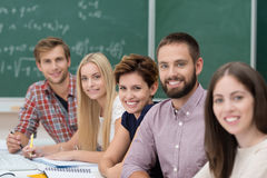Group of happy successful university students Stock Image