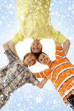 A group of happy teenage boys on a snowy background. A group of happy smiling teenagers. The image is taken on a snowy Christmas background Royalty Free Stock Photos