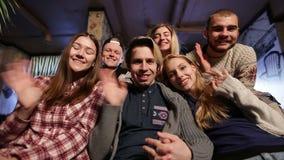 Group of happy teenage friends waving hands stock video footage
