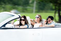 Group of happy teenagers in the cabriolet. Group of happy teenagers driving the cabriolet. Adorable car trip on vacation Royalty Free Stock Photography