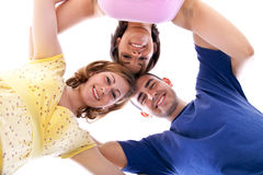 Group of happy teenagers in circle. – view from below Stock Photos
