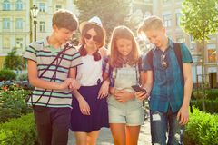 Group of happy teenagers friends 13, 14 years walking along the city street. stock images