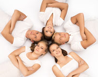 Group of happy teenagers isolated on white Stock Photography