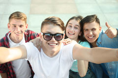 Group of happy teenagers. A group of happy teenagers makes selfies Royalty Free Stock Photography