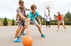 Group of happy teenagers playing basketball Royalty Free Stock Photo