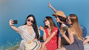 Group of happy travel woman taking selfie using smartphone having positive emotion at sea background. Group of happy travel woman taking selfie using smartphone stock video footage