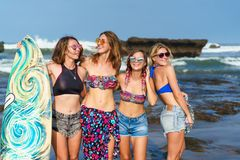 Group of happy women in bikini with surfboard posing. On beach royalty free stock photos