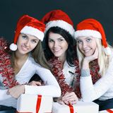 Group of happy women in costumes of Santa Claus and Christmas s. Hopping . isolated on black.photo with copy space Stock Photography