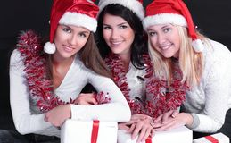 Group of happy women in costumes of Santa Claus and Christmas s. Hopping . isolated on black.photo with copy space Royalty Free Stock Images