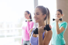 Group of happy women with dumbbells in gym Royalty Free Stock Photos
