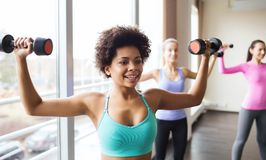 Group of happy women with dumbbells in gym Royalty Free Stock Photo