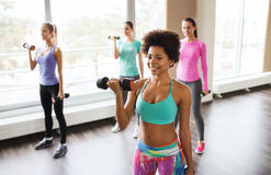 Group of happy women with dumbbells in gym Stock Photography