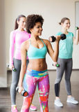 Group of happy women with dumbbells in gym Stock Photos
