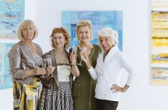 Group of happy women. Group of happy elegant women spending time in museum Royalty Free Stock Images