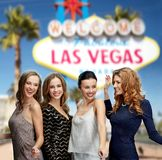 Group of happy women or friends at las vegas party Stock Photos