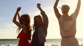 Group of happy women or girls dancing on beach 35 stock footage