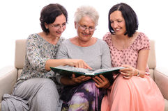 Group of happy women sharing photo memories Stock Photos