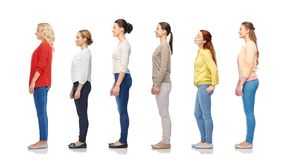 Group of happy women standing in line stock photos