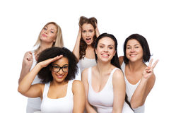 Group of happy women in white underwear having fun Royalty Free Stock Photo