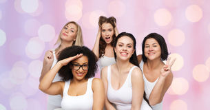 Group of happy women in white underwear having fun Stock Photo
