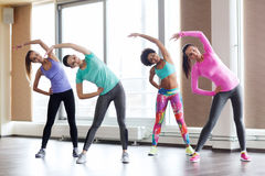 Group of happy women working out in gym Stock Photos