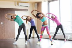 Group of happy women working out in gym Stock Photography