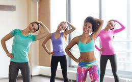 Group of happy women working out in gym Stock Photo