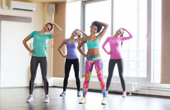 Group of happy women working out in gym Royalty Free Stock Images