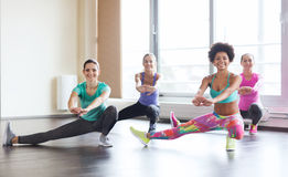 Group of happy women working out in gym Royalty Free Stock Photography