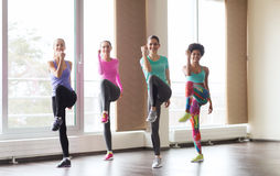 Group of happy women working out in gym Stock Images