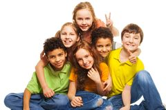 Group of happy kids. Group of happy, 10 years old boys and girls smiling, gesticulating and hugging Stock Images