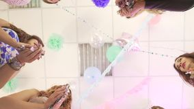 Group of happy young attractive excited female friends having fun enjoy dance celebrating birthday party at beauty salon stock footage