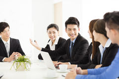 Group of happy young business people in  meeting Stock Photos