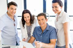 Group of happy young business people in a meeting. At office Stock Photos