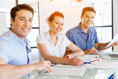Group of happy young business people in a meeting. At office Royalty Free Stock Photography