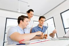 Group of happy young business people in a meeting Stock Image