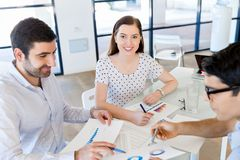 Group of happy young business people in a meeting Royalty Free Stock Image