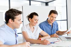 Group of happy young business people in a meeting Stock Photography