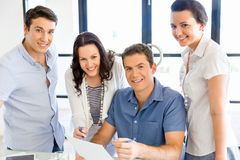 Group of happy young business people in a meeting Royalty Free Stock Photo