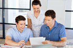 Group of happy young business people in a meeting. At office Stock Photography