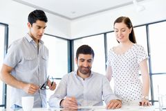 Group of happy young business people in a meeting Stock Images
