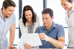 Group of happy young business people in a meeting. At office Royalty Free Stock Photo