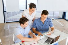 Group of happy young business people in a meeting. At office Royalty Free Stock Photos