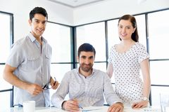 Group of happy young business people in a meeting. At office Stock Photo