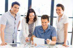 Group of happy young business people in a meeting Stock Photos