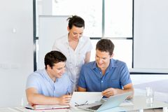 Group of happy young business people in a meeting Royalty Free Stock Photography