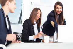 Group of happy young business people in a meeting at office Royalty Free Stock Image