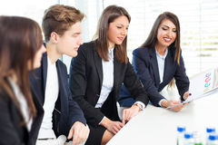 Group of happy young business people in a meeting at office Royalty Free Stock Images